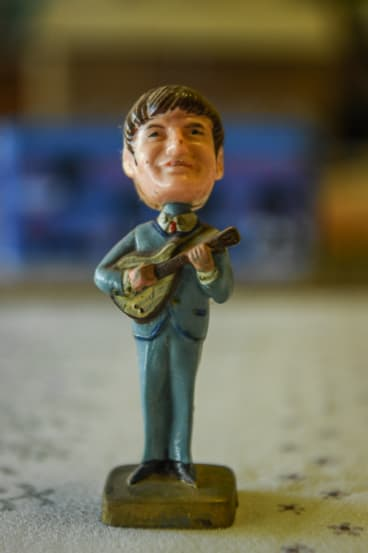 A John Lennon figure is part of Chris McDonald's vast Beatles' memorabilia collection.