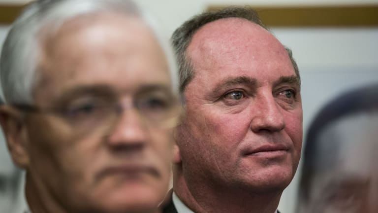 Former Nationals leader Barnaby Joyce listens to the party's new leader, Michael McCormack, address the media on Monday.