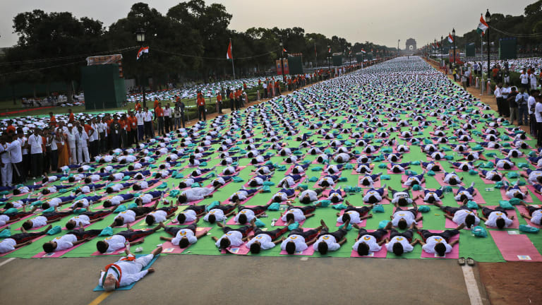 Prime Minister Narendra Modi leads thousands of Indians in a yoga celebration.