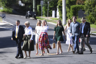 Chloe Shorten, in red skirt, attends an Easter service with (from left) Bill Shorten, mother Quentin Bryce, sister Revy Bryce-Browning, daughter Gigi, niece Alexandra Browning, son Rupert and father Michael Bryce.