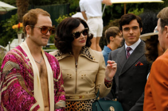 Taron Egerton as Elton John, Bryce Dallas Howard as  Elton's mother Sheila Farebrother and Richard Madden as John Reid in Rocketman,