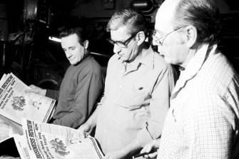 (Left to right) Bob Dempsey (National Times production editor), Evan Whitton (editor) and Vic Carroll have a look at the first printing of the National Times Business Review at John Fairfax in Sydney's Broadway on 6 September, 1980.