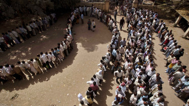 Unemployed Indians line up for a government job in Uttar Pradesh.