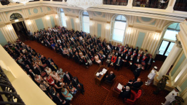 Queensland Governor Paul de Jersey addressings members and their guests in the old upper house.