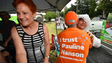 Pauline Hanson (left) and former One Nation senator Malcolm Roberts (centre) with Jo-Ann Miller (right) in Bundamba on Tuesday.