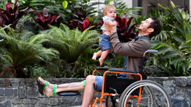 The world's first patient to receive a 3D-printed tibia transplant, Reuben Lichter, with his son, William.