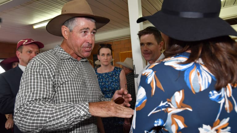 Local farmer Jim Hancock confronts Premier Annastacia Palaszczuk about vegetation management at the Kumbia Race Club.