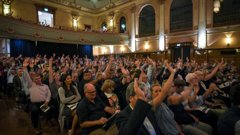 Trinity Grammar community members give the school council a vote of no confidence in a meeting at Hawthorn Town Hall on Tuesday night.