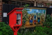 The little library and a Brigitte Dawson painting in Laz's Lane.