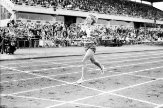 Betty Cuthbert hits the tape in a new world record time.