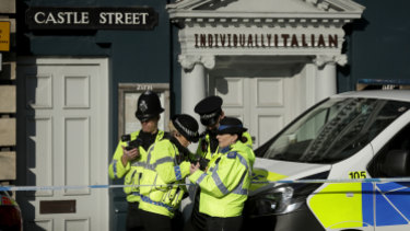 British police guard a restaurant in Salisbury, near to where Sergei Skripal was found critically ill.