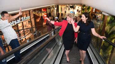 Premier Annastacia Palaszczuk and Mansfield electorate candidate Corrine McMillan wave to a shopper in  a last-minute visit to the electorate on Friday.