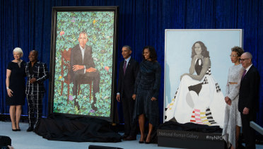 National Portrait Gallery director Kim Sajet (far left) unveiled the official portraits of Barack and Michelle Obama painted by Kehinde Wiley and Amy Sherald.