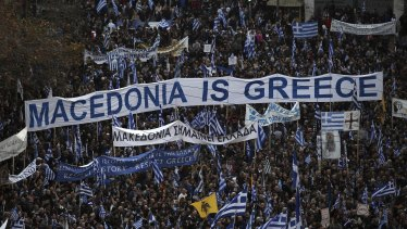Protesters gather during a rally in Athens on  Sunday.