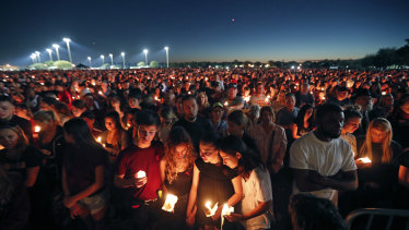 People attend a candlelight vigil for the victims of the Wednesday shooting at Marjory Stoneman Douglas High School, in Florida.