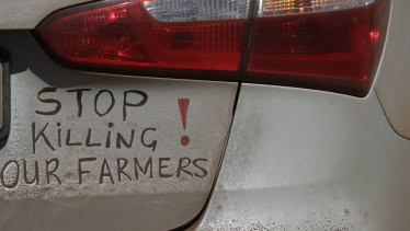 A bumper sign during a blockade of the freeway between Johannesburg and Vereeniging, in Midvaal, South Africa, last year in protest against the murder of farmers.