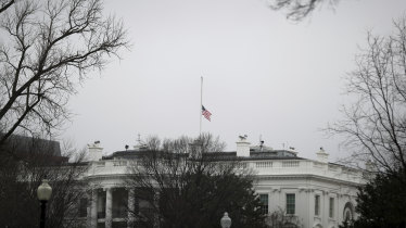 The United States flag at half mast.
