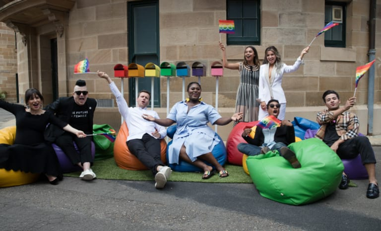 (L-R) Yael Stone, Lea Delaria, Jonathan Groff, Danielle Brooks, Alisha Boe, Dannii Minogue, Samira Wiley and Christian Navarro who are all part of the Netflix  float at the Sydney Gay and Lesbian Mardi Gras Parade on Saturday.
