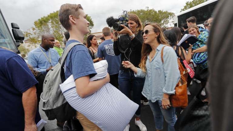 Logan Locke, 17, a student who survived the shooting at Stoneman Douglas High School, talks to media.
