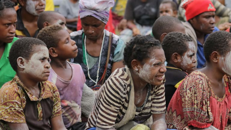 Children from Baguale village waiting for food.