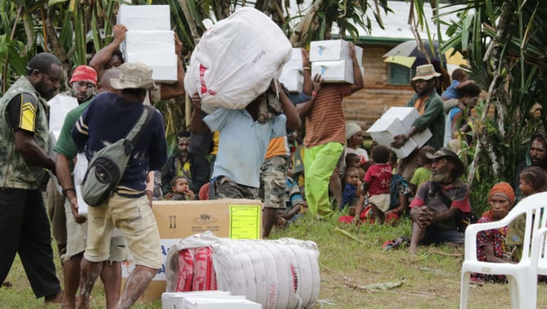 Locals from Baguale village in Kutubu, bringing in relief supplies brought by Oil Search Limited to their villages in earthquake devastated PNG.
