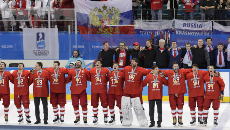 In full song: Players defied a ban on singing the Russian national anthem at the awards ceremony.