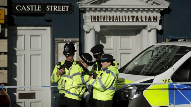 British police guard a restaurant in Salisbury, near to where Sergei Skripal was found critically ill.