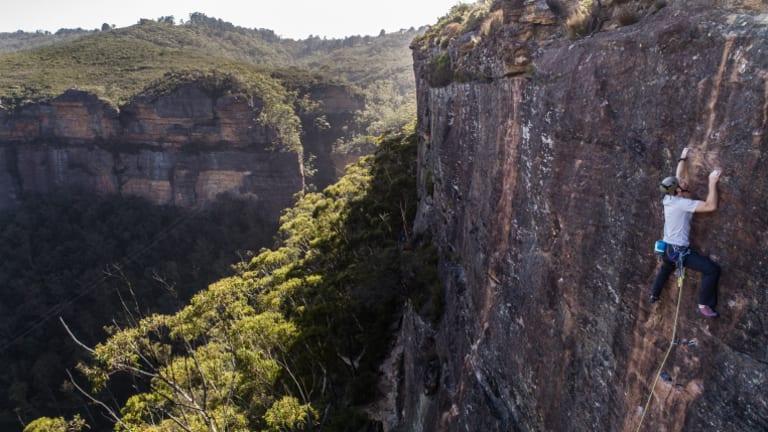 David Ralphs climbs The Bandoline Grip on the Upper Shipley crag in Blackheath while his wife Bronwyn belays below.