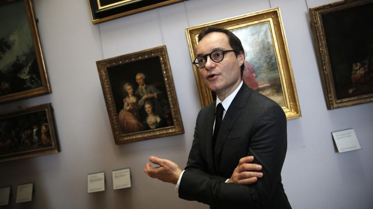 Head of the paintings department at the Louvre museum, Sebastien Allard, with paintings looted by Nazis during World War II, in Paris.