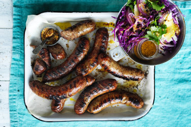Barbecuedsausageswith red cabbage and mustard salad.