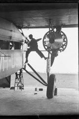 Technician working on Charles Kingsford Smith's Southern Cross aircraft, NSW, ca. 1931