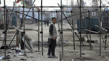 A man stands at site of the suicide attack in Kabul on Friday.