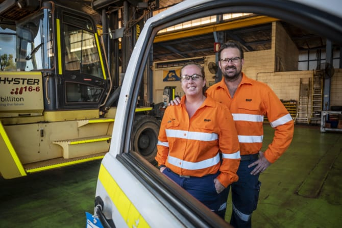 Toni McMahon and husband Clint at the Light Vehicle workshop at BHP's Nelson Point facility in Port Hedland.