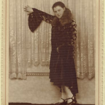 Esther Rudov models one of the Parisian dresses she brought back from her1938 trip to Poland and Germany.