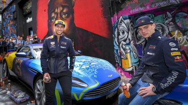 F1 drivers Daniel Ricciardo and Max Verstappen with the work of street artist Julian Clavio.