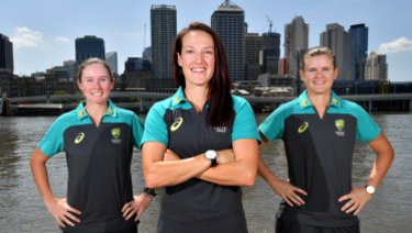 Australian women's cricket team mates  Beth Mooney, Megan Schutt (centre) and Jess Jonassen (right) at South Bank earlier this month.