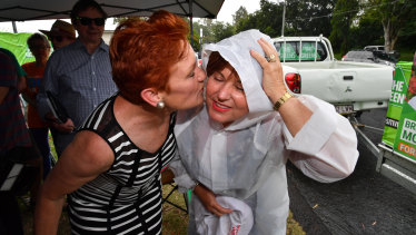 One Nation leader Senator Pauline Hanson (left) and ALP member for Bundamba, Jo-Ann Miller (right) are seen together in the suburb of Bundamba in Ipswich on Tuesday.