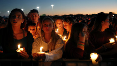 People attend a candlelight vigil for the 17 victims on Thursday night.