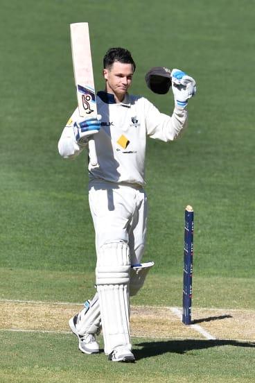 Centurion: Victorian Peter Handscomb celebrates reaching 100 runs against South Australia.