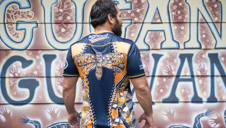 Robbie Abel models the Brumbies' new indigenous warm up jersey
