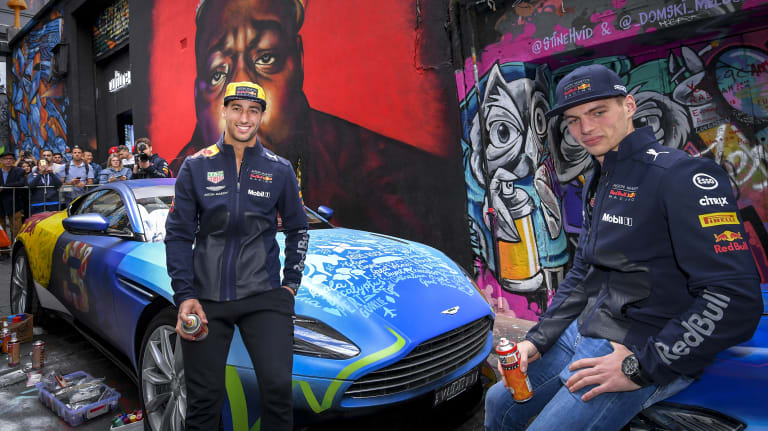 F1 drivers Daniel Ricciardo and Max Verstappen with the work of street artist Julian Clavio.