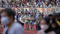 People line up to get vaccinated at the Gelora Bung Karno Main Stadium in Jakarta.