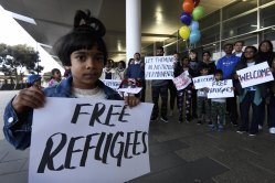 Supporters welcoming the Murugappan family at Perth Airport last week.