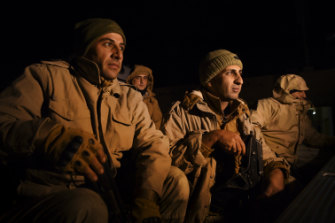 Peshmerga soldiers in the back of a ute wait to start their night patrol of the border between Iraqi Kurdistan and Syria.
