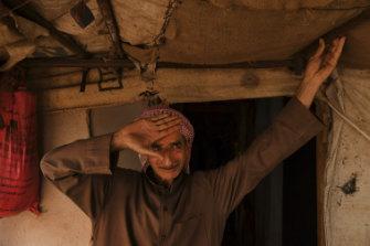 Abdelmeneim Moustafa, 54, in front of the temporary shelter he calls home in Saideh camp.