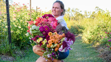 Mt Lawless Organic Flower Farm owner Natalie Harris with a selection of her blooms.