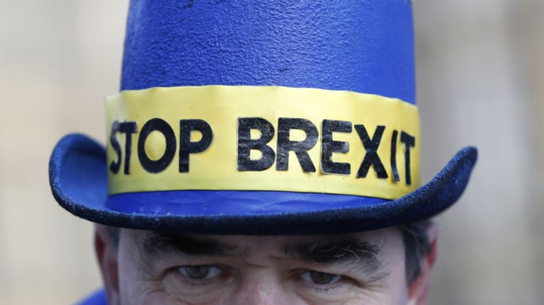 An anti Brexit demonstrator wears a hat in Westminster in London.