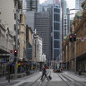 The virus has left city streets and offices, like George Street in Sydney, empty.