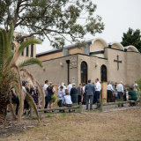 People gather outside the Macedonian Orthodox Church of St Kiril i Metodi in Sydney.