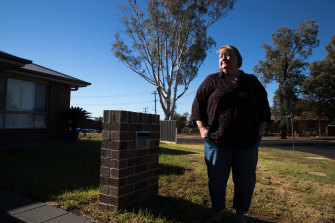 Nerida Baxter outside her house on what is  now known as Rosewood Grove, across the road from Mark Ebsworth.